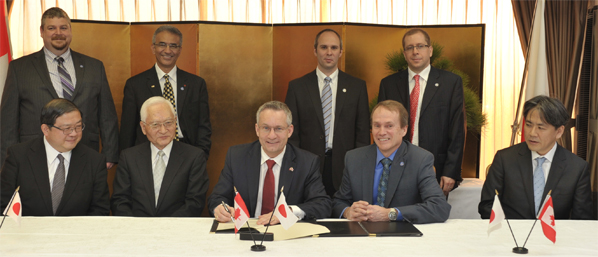Minister Fast signs space collaboration memorandun with Japan.
