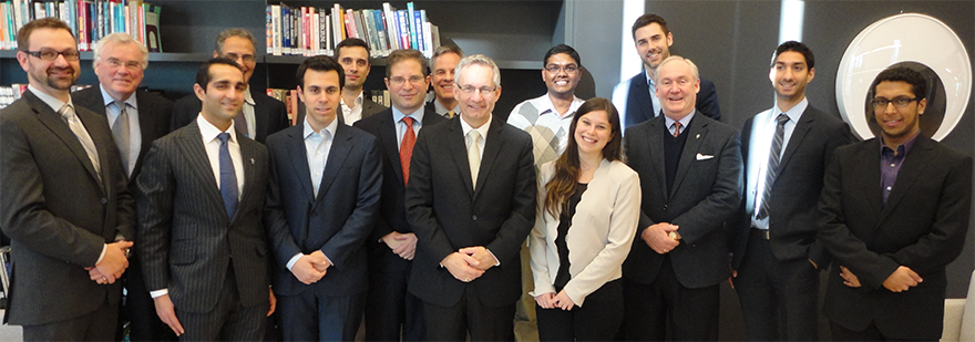 Minister Fast with students and professors at the University of Toronto's Rotman School of Management