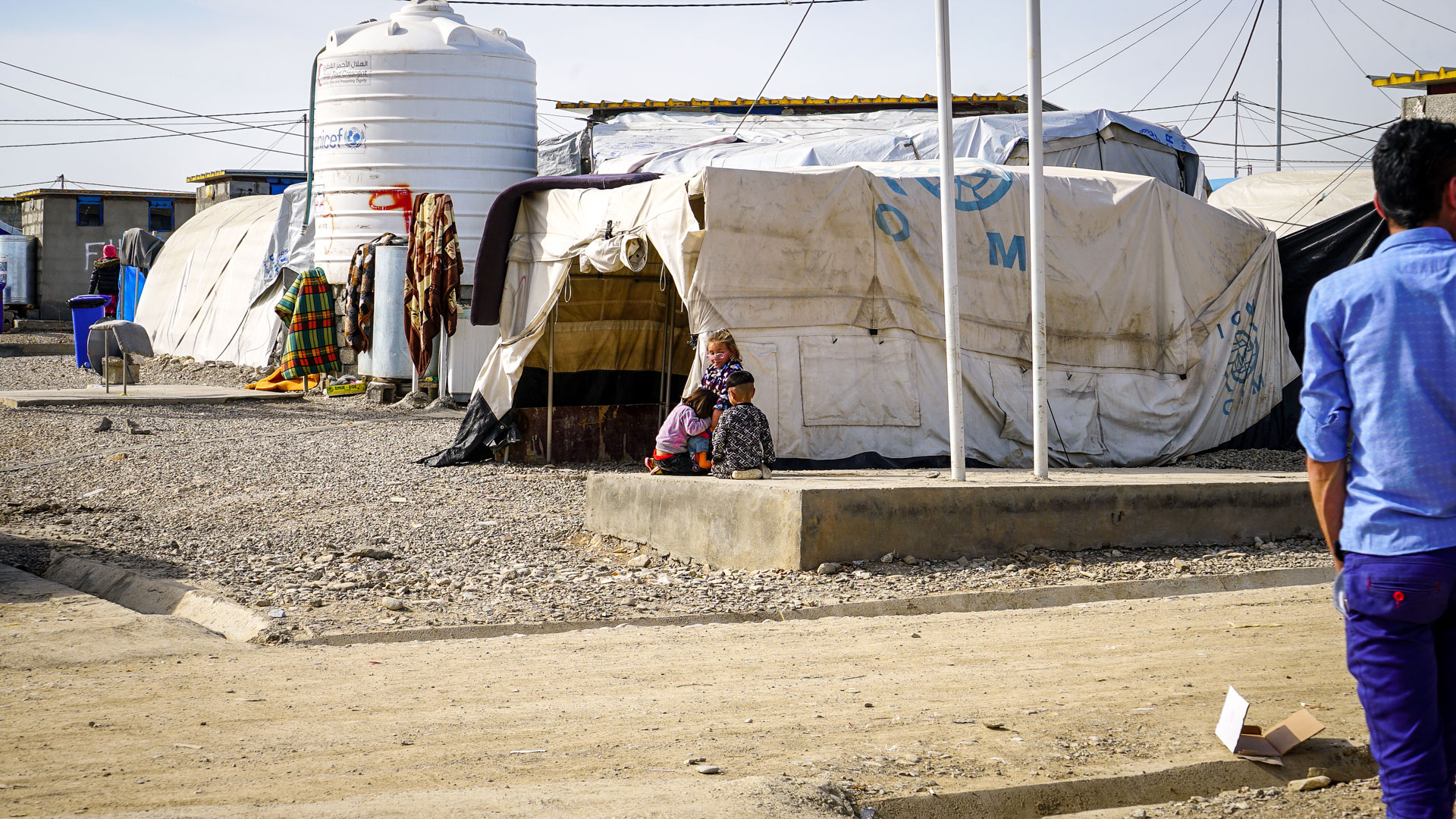 Children are playing at a camp for internally displaced persons in Iraq.