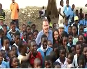 Embassy staff in Mozambique pose for a picture at a local school in an impoverished area of the country.