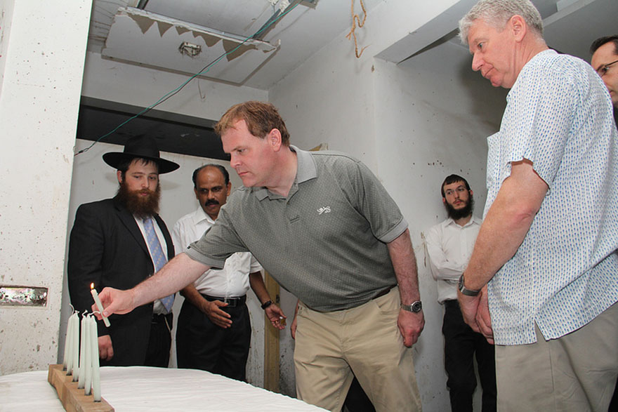 Baird lights candle at Chabad House in Mumbai