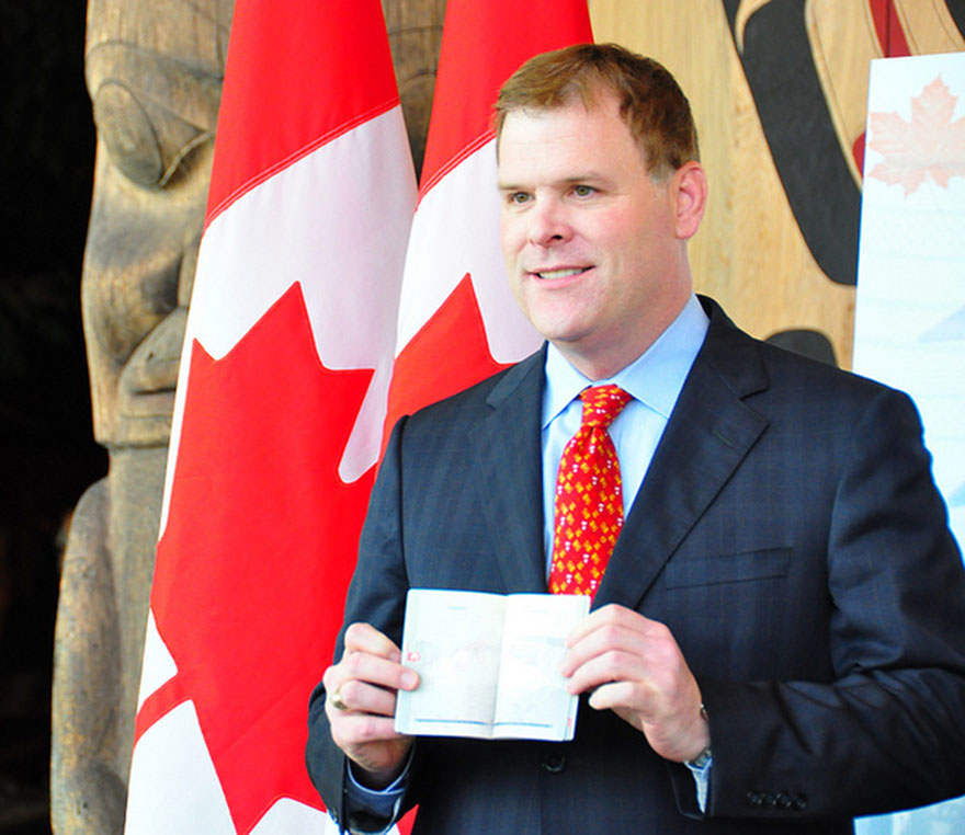 Foreign Affairs Minister John Baird attends the unveiling of the design of Canada's ePassport