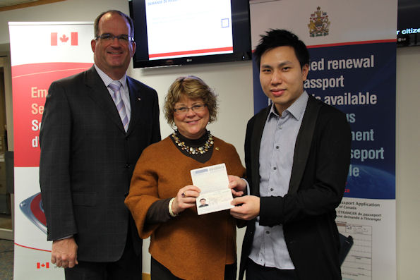 Minister Ablonczy and J. Ian Burchett, Canada's consul general in Hong Kong, present Law Kok Yu with his renewed Canadian passport