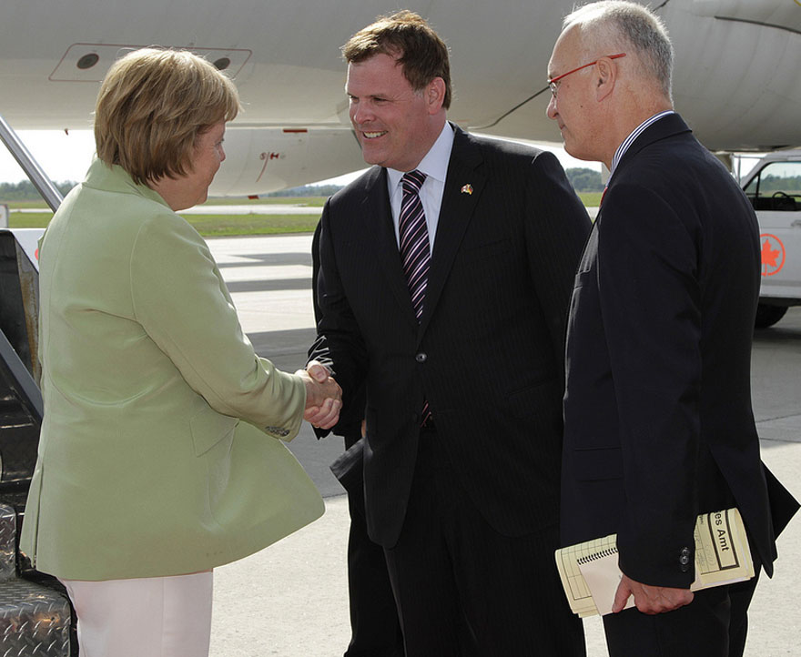 Baird Greets Germany's Chancellor Merkel