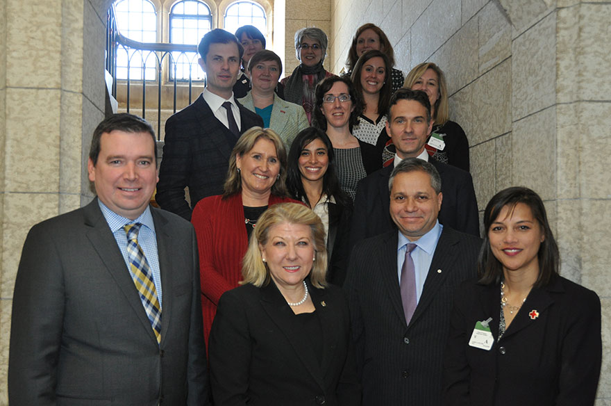 Minister Paradis, Parliamentary Secretary Lois Brown and members of the Canadian Network for Maternal, Newborn and Child Health