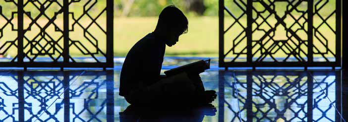 Muslim child recites Al-quran at mosque in Malaysia. Credit: Shutterstock