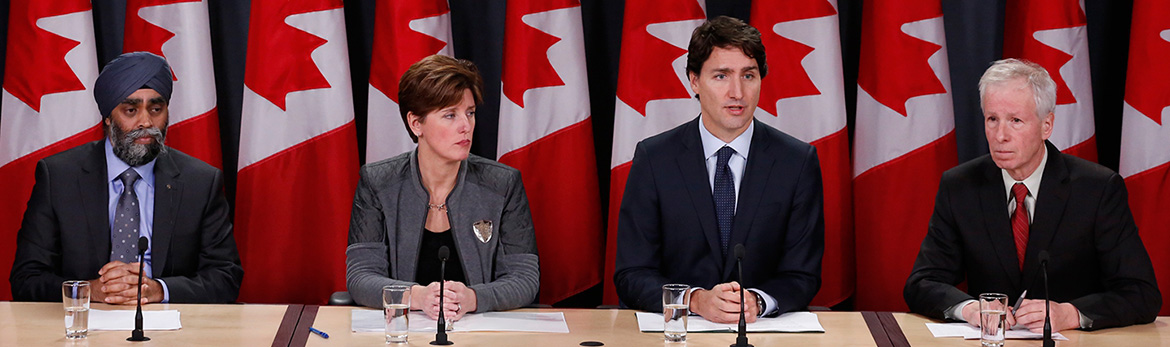 The Prime Minister, Justin Trudeau, along with the Minister of Foreign Affairs, the Honourable Stéphane Dion (right), the Minister of National Defence, the Honourable Harjit S. Sajjan (furthest left), and the Minister of International Development and La Francophonie, the Honourable Marie-Claude Bibeau (left), make an important announcement in Ottawa.