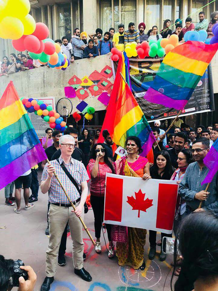 Consul General Christopher Gibbins holds the Pride flag during Chandigarh's 2018 Pride Week.