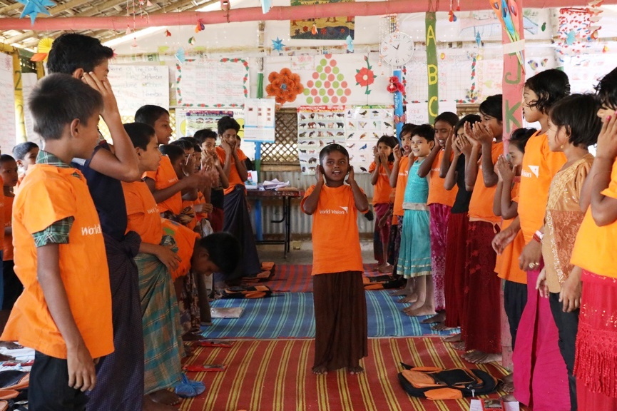Amina leads her friends in an action song at a Canada-supported World Vision child-friendly space in Cox's Bazar.Photo: Himaloy Joseph Mree/World Vision