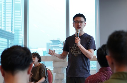 Chi-Wei Chung from the Taiwan LGBTQ Hotline speaks at Canada's Trade Office in Taipei.