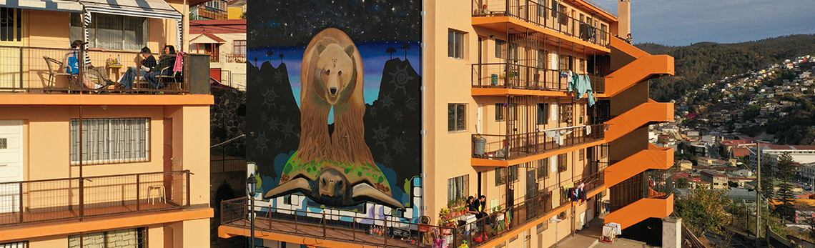 A mural on the side of an apartment complex in Chile