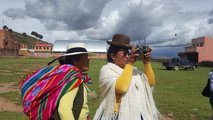 A member of the Women United for Water Network of Lake Titicaca uses drone technology to monitor water contamination