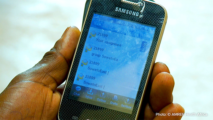 """Perhaps <q>""""Villagers access information about COVID-19 through cellphone applications such as WhatsApp.""""</q> Photo: AMREF Health Africa"""