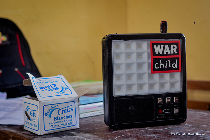Radios provide an engaging way for young students to learn about health and education. Photo: David Kalonji